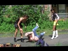 Boots trampling and kicking by 2 young mistress 2