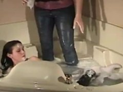 Two girls in jacuzzi fully clothed
