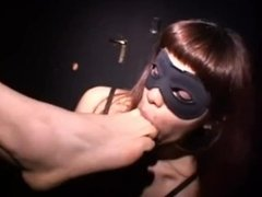 Slave in mask licks piss off male feet