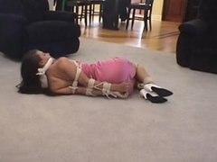 Sasha Fae floor tied and cleave gagged in pink dress