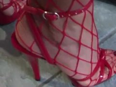 Mature Darla Is Folding Dish Towels In Red Fishnet Stockings