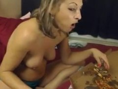Topless woman belly stuffing