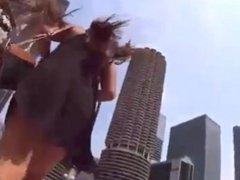 Stupid girl windy upskirt exposing her big ass in tight thong on hidden cam