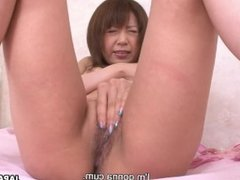 Rubbing her wet coochie and cumming at the same time