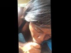 Ebony MILF eating a Black cock in the car