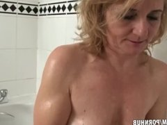 Isabella gets her fur wet in the bath
