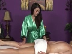 BUSTY GIRL GIVES A LESBIAN MASSAGE TO HER BUSTY CLIENT