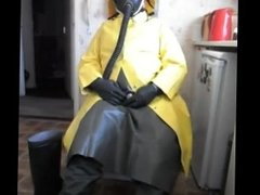 Pissing and wanking in green rubber apron and yellow rubber coat.