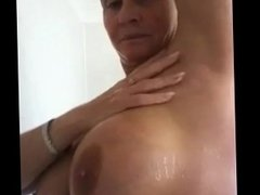 Showing off her huge tits in the shower