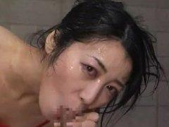 Japanese pornstar strokes a stiff pecker till she gets greased warm load