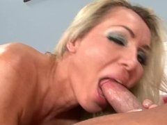 BUSTY BLONDE MILF RIDES HARD COCK WHILE HUSBANDS AWAY