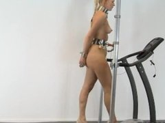 Dominatrix is tied to a treadmill for a taste of her own medicine