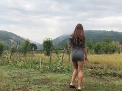 Sexy brunette teen candid walkin in tight minidress is exposing her big ass