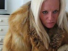Blonde escort in fur coat suck a cock