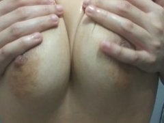 thick latina massaging her huge tits