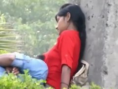 Girl in Red with Naughty Lover Romancing in Park
