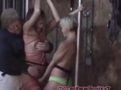 Two girls tied and tickled