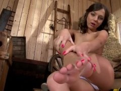Beautiful girl masturbates using her feet