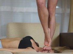 Lesbian Mistress enjoys standing on her Girlfriend's Head
