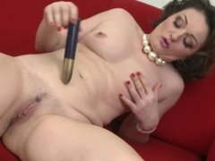 Small titted brunette mature toying her pussy