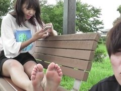 Japanese teen girl soles tickled in park