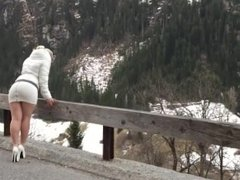 Hot & sexy blonde MILF mountain walking in tight miniskirt exposes her ass!