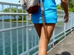 2 hot MILFs in tight bikini thong exposing their big butts to voyeurs !