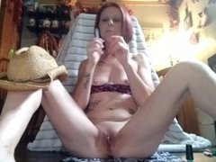 Sexy cowgirl paints her toes while masterbating and smoking a cigarette