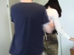 Dark-haired girl with white blouse bound and gagged