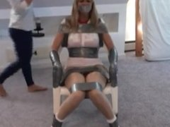 Cheerleader taped to a chair