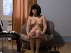 A young brunette tries on nylon pantyhose. Feet fetish