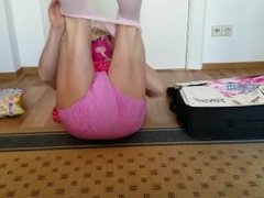 sissy packs her suitcase for vacation while pissing her diapers