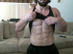 Bodybuilder flexing on cam