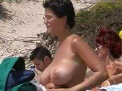 Voyeur cam caught bigtits beach milf lotioning