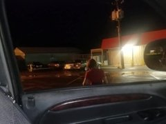 Red head gives blowjob in the parking lot of her job after work