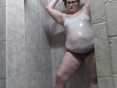 BBW gets her clothes all wet in public shower