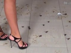 super hot girl crushing snails in super high heels.