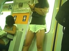 Candid Asian girl in shorts.