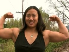 Muscle girl flexing