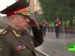 Putin caught in heavy rain during ceremony