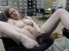 Busty redhead gets horny at work