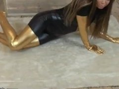 girl in a tight black and golden catsuit