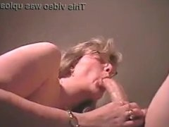 Blonde mature whore sucks a cock that seems painful and to big for her !