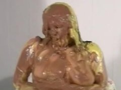 Girl covered in chocolate and pied in the face