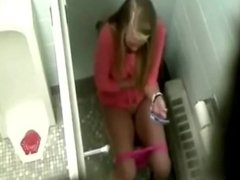 Girl seats in toilet and pees