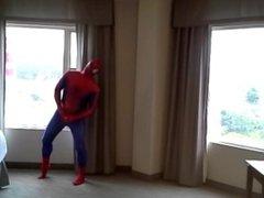 spiderman jerking off at hotel window