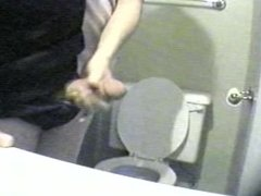 wife giving husband a handjob in bathroom