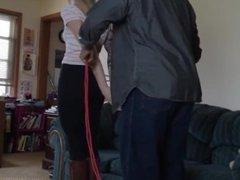 Girl bondage in red rope