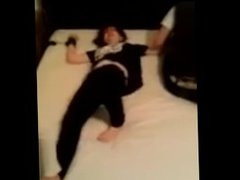 girl tied to bed by friends and tickled