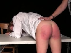 Girl Is Spanked Hard With Leather Paddle While In Detention